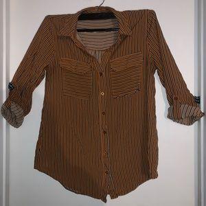 Women's dress button up shirt.